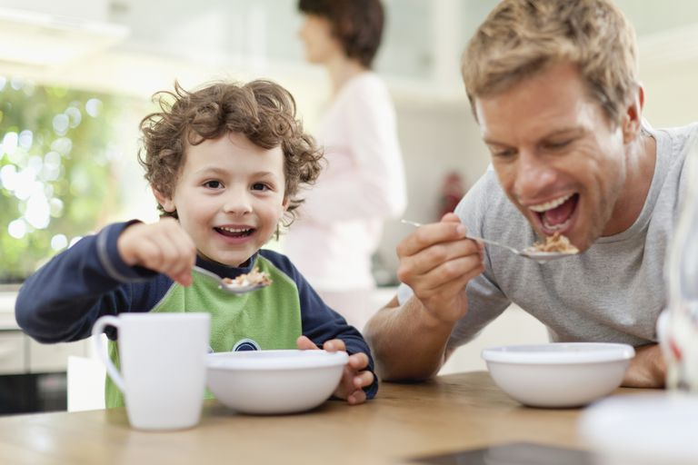 Far and son eating cereal