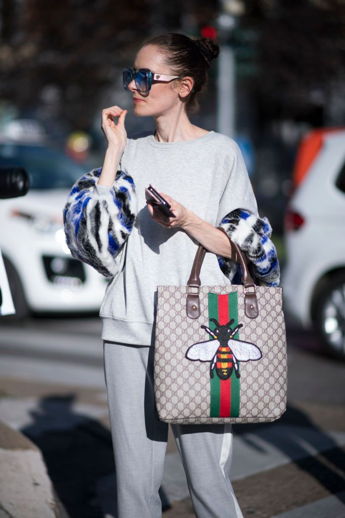 Ulica style woman in sweatsuit and Gucci purse