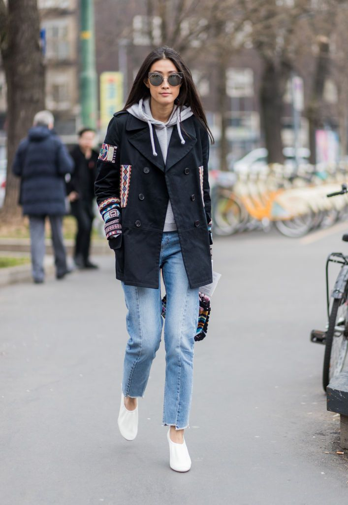Ulica style woman in jeans and sweatshirt