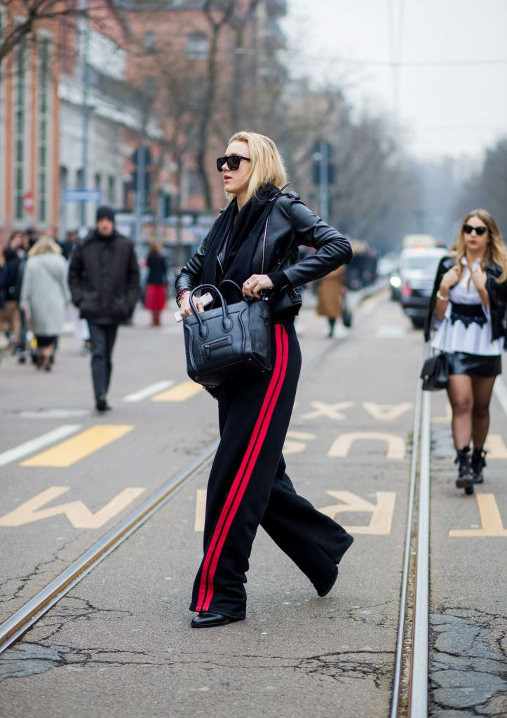 Ulica style woman in leather jacket and track pants