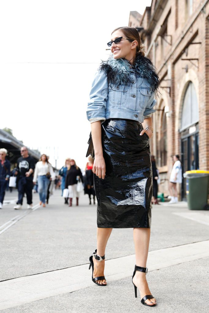 אִשָׁה wearing denim jacket and pleather skirt