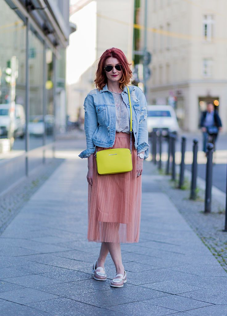 Улица style in a denim jacket and floaty maxi skirt