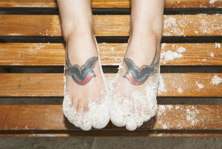 Pijesak and two tattooed swallows on woman's feet