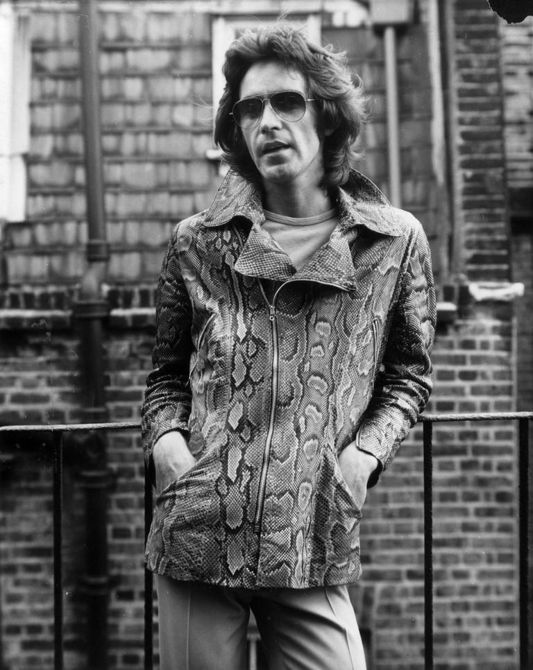 6тх July 1970: Fashion designer Ossie Clark (1942 - 1996) modelling a snake skin zip fronted jacket.