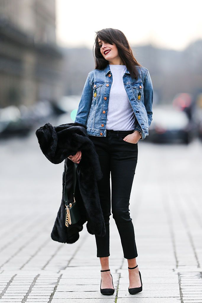 Gata style woman in denim jacket and black jeans