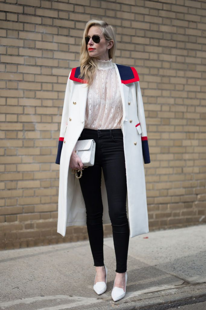 Gata style in lace blouse, jeans and a coat