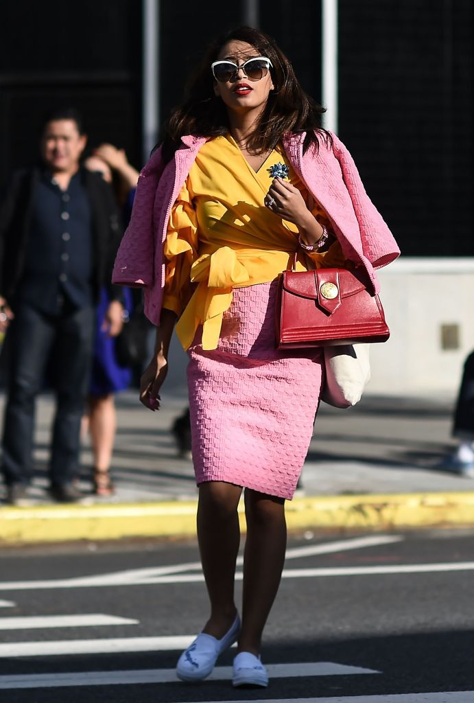Gata style woman in pink skirt suit