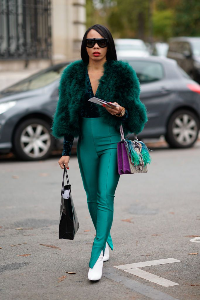 utca style woman in green outfit