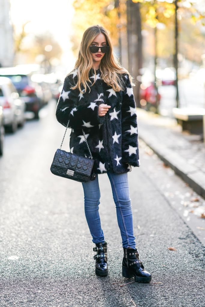 faux fur coat with stars and jeans