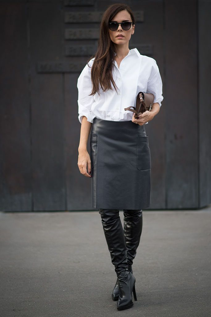 महिला wearing a pencil skirt and white shirt