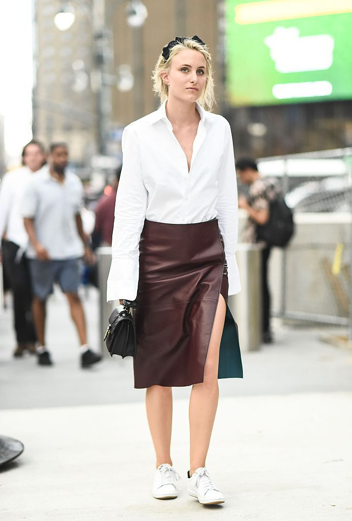 महिला in white shirt and leather skirt