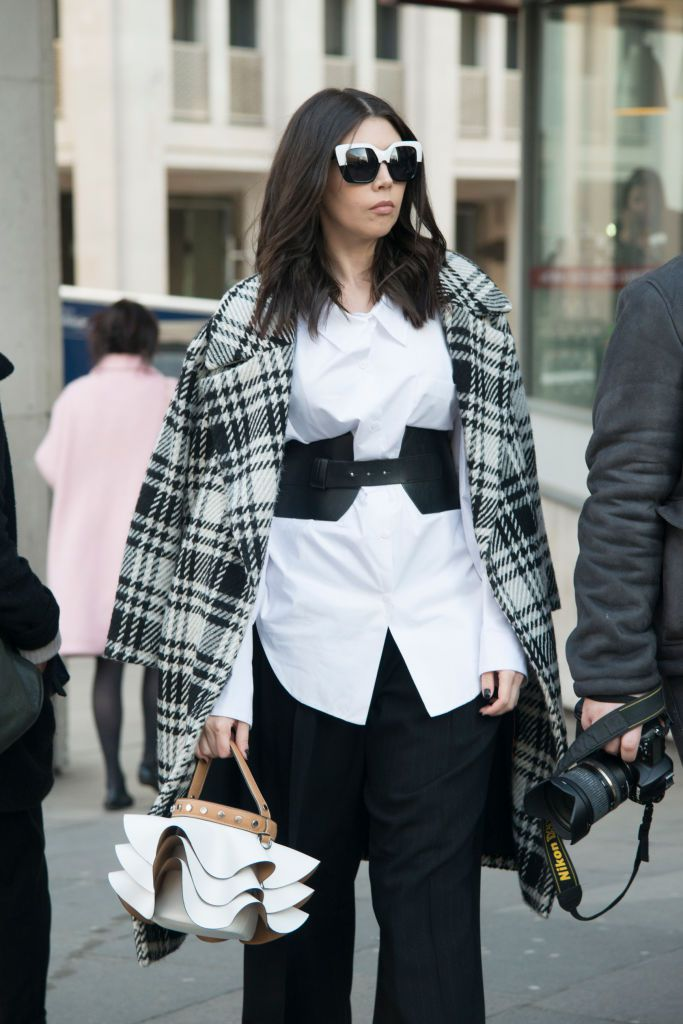 महिला in belted white shirt and plaid coat