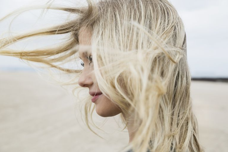 Blond haired woman on beach