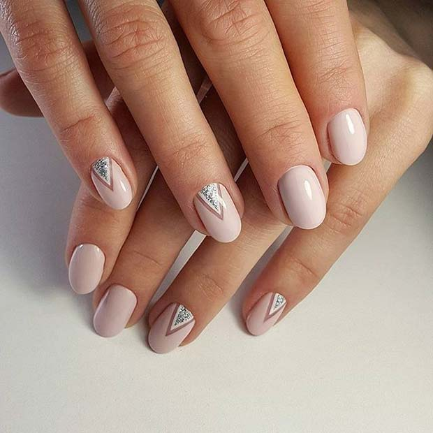 Fény Pink Manicure with Glitter Triangle Accent for Glitter Nail Design Idea