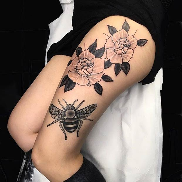 דבורה and Flowers Thigh Tattoo Idea