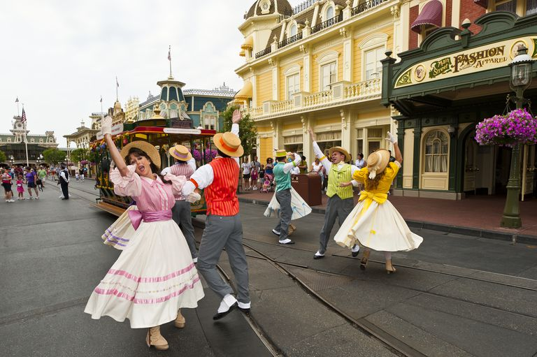 Диснеи performers and a street trolley on Main Street U.S.A.