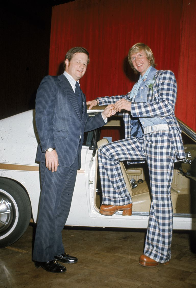 1974 photo of hockey player Gary Unger receiving a new car in a checkered suit and heeled platform shoes.