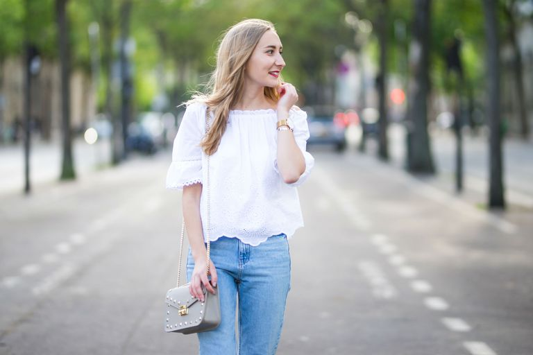 utca style woman in jeans and white blouse