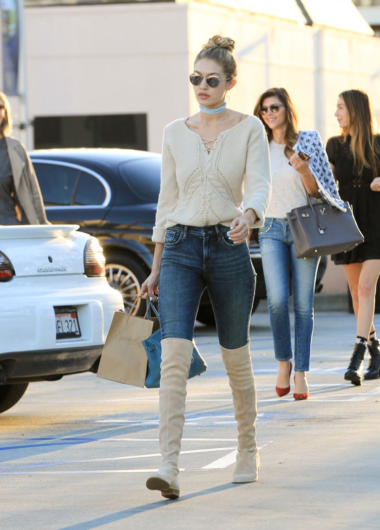 Gigi Hadid wearing skinny jeans and tall boots in Los Angeles