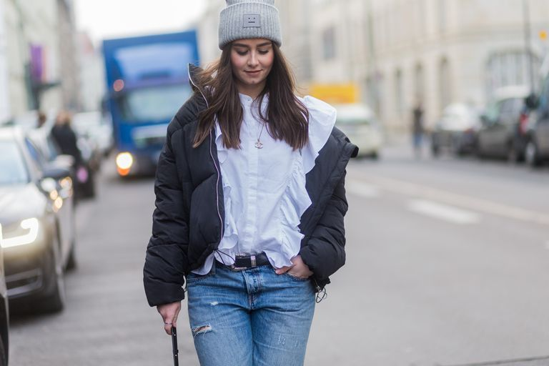 utca style in puffer jacket and jeans