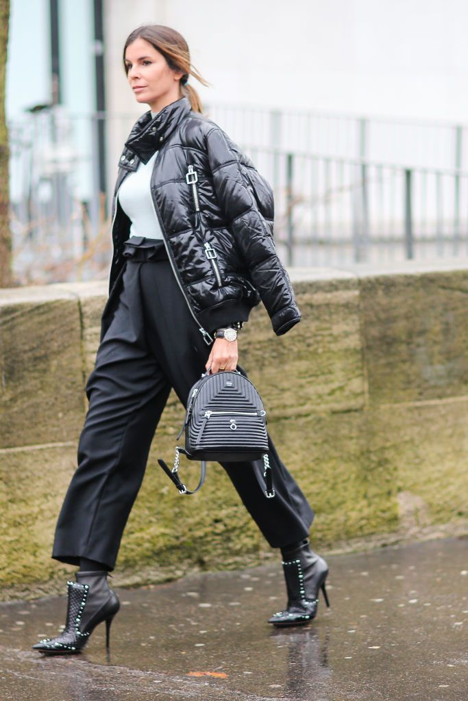 utca style outfit for work in black puffer coat
