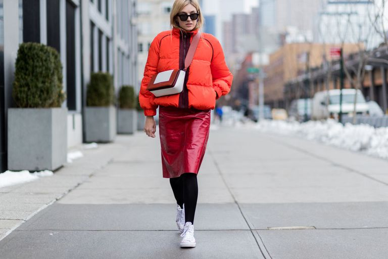 utca style in puffer coat and leather skirt