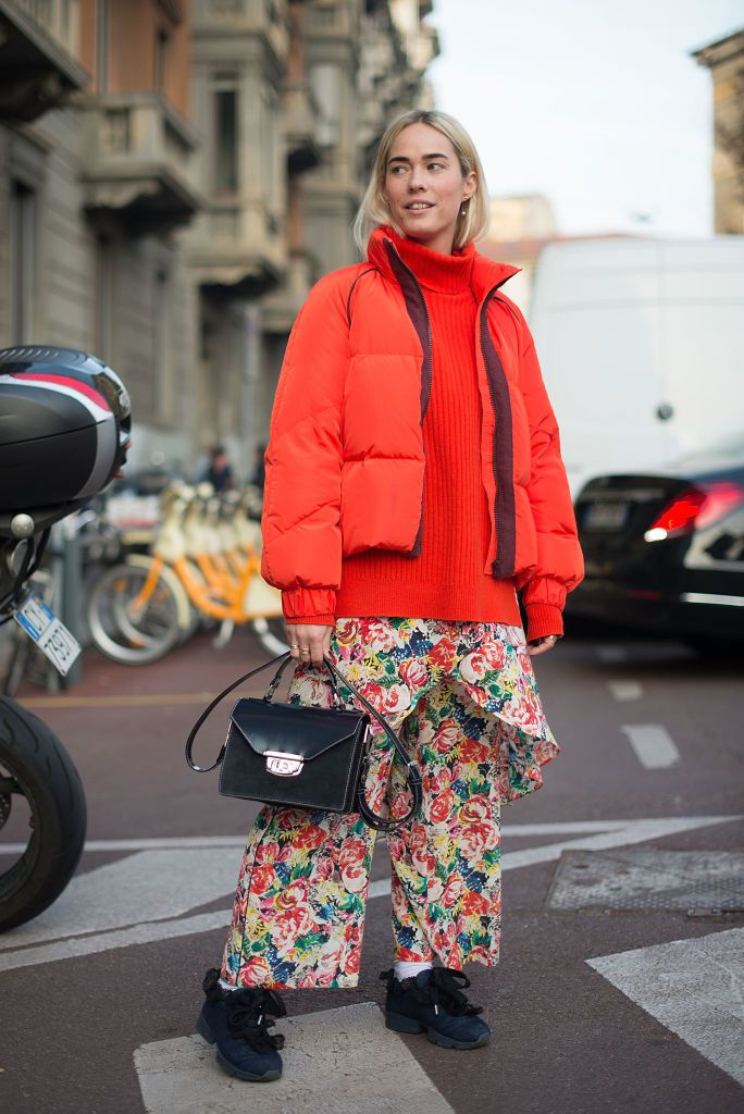 utca style in floral pants and red puffer coat