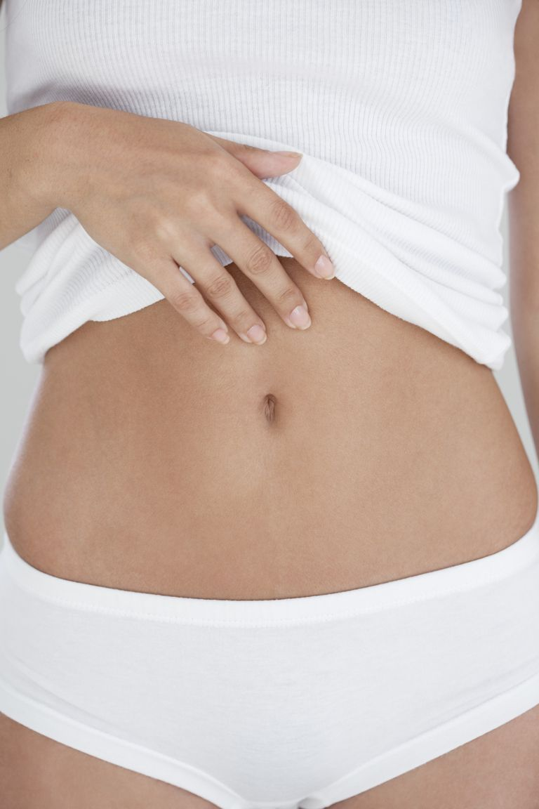 како to wax stomach