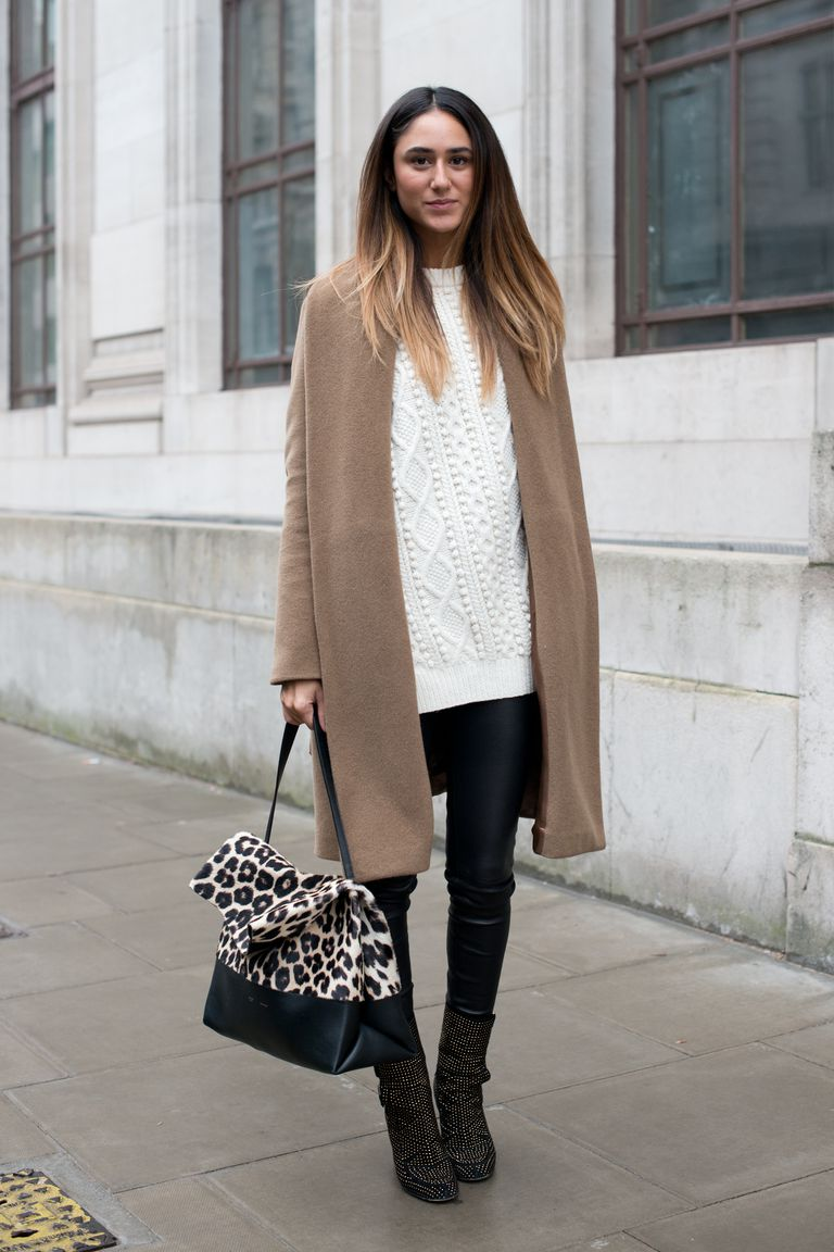 महिला in leather leggings and sweater and coat