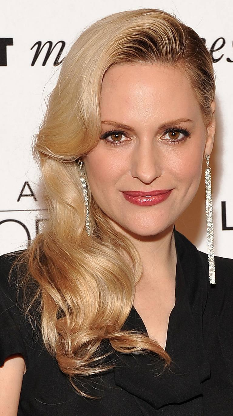 Aimee Mullins with bombshell curls