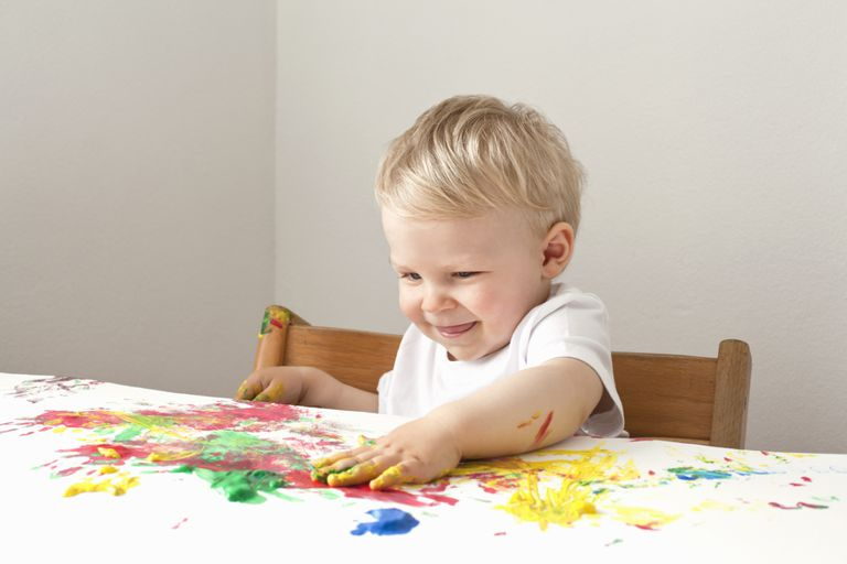 Malo boy playing with finger paints