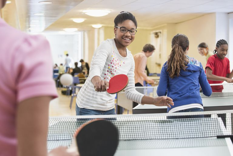 copii playing table tennis in community center