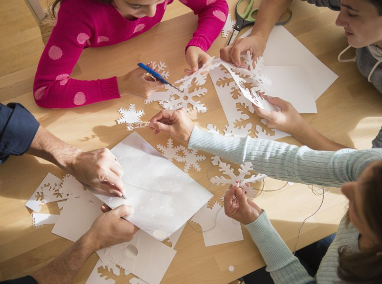 vit family cutting out paper snowflakes