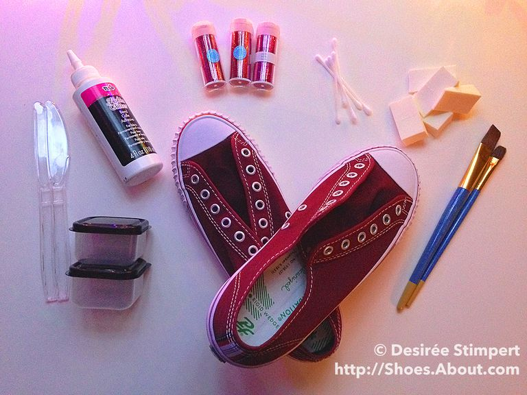 Дарк red canvas sneakers, paint brushes, wedge sponges, q-tips, glitter vials, adhesive, plastic knives, plastic bowls with lids.
