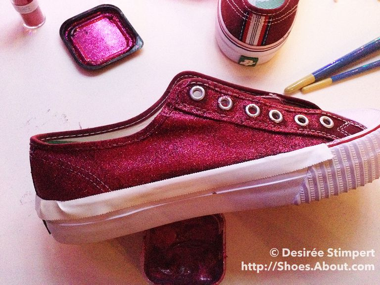 Црвена canvas sneaker with masking tape covering rubber sole.