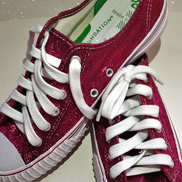 Цлосе-уп image of final glittered sneakers. Red with white shoelaces.