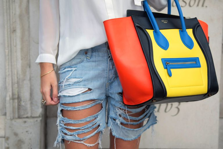 Дистресед jean shorts and designer purse