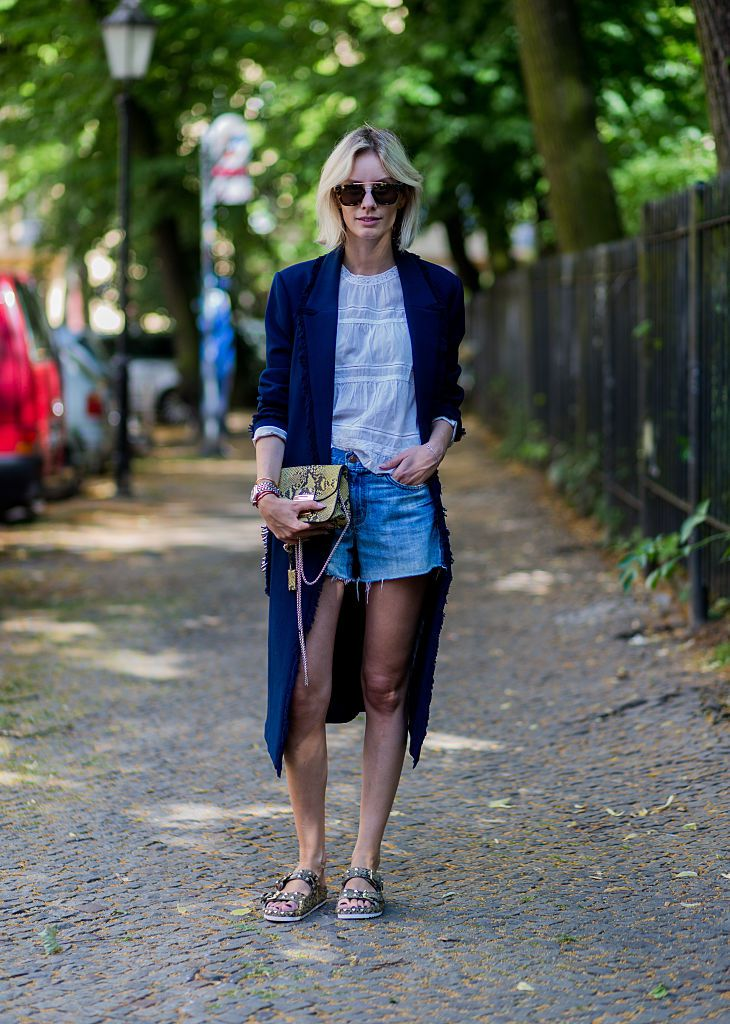 Denim shorts and Furla purse street style