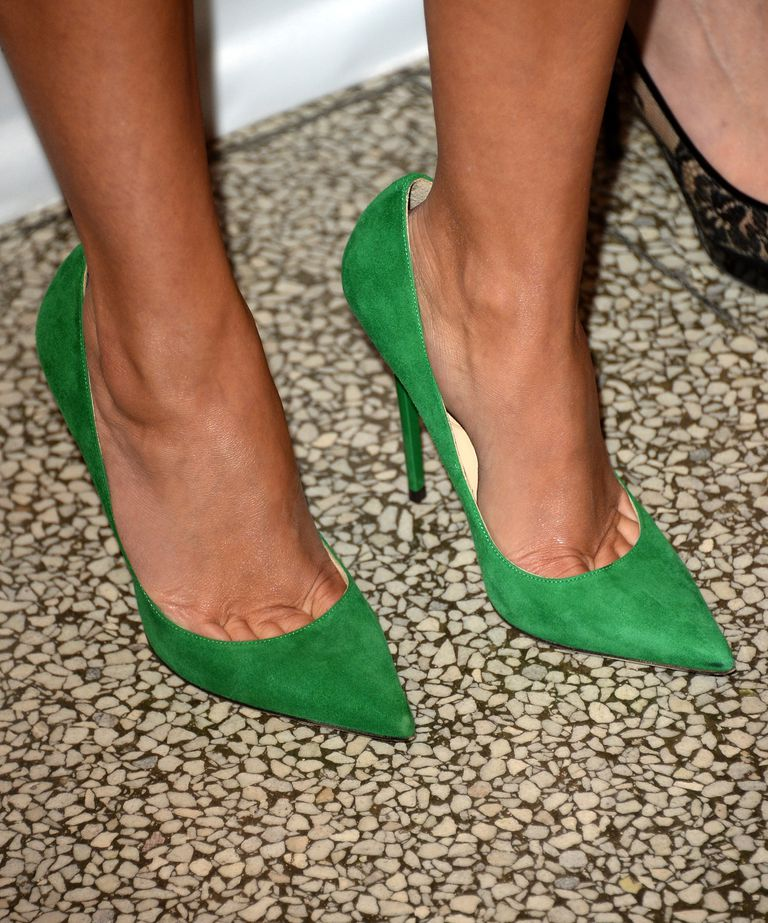 A închide of green suede pumps, as worn by actress Reese Witherspoon.