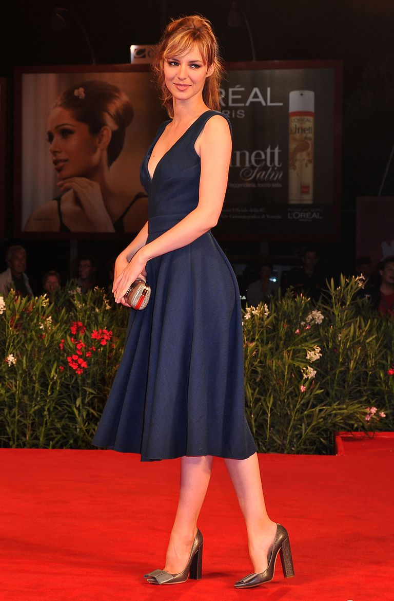 Louise Bourgoin wearing brown shoes with a navy evening dress.