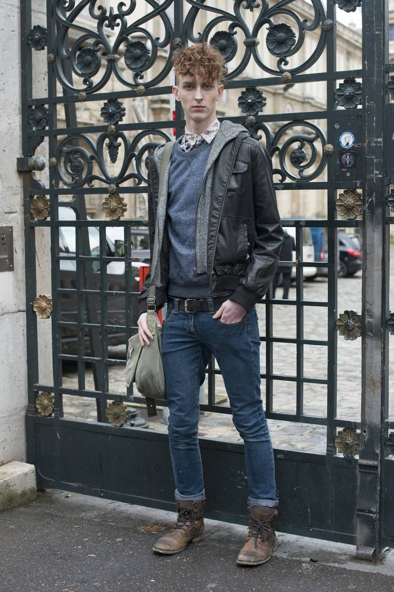 Model Matthew Johnstone wears River Island boots, Topman shirt and Burton jeans and sweater day 5 of Paris Mens Fashion Week