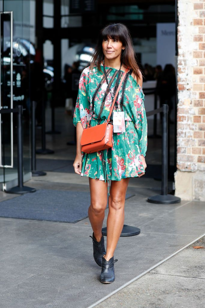 หญิง wearing floral print short summer dress and ankle boots