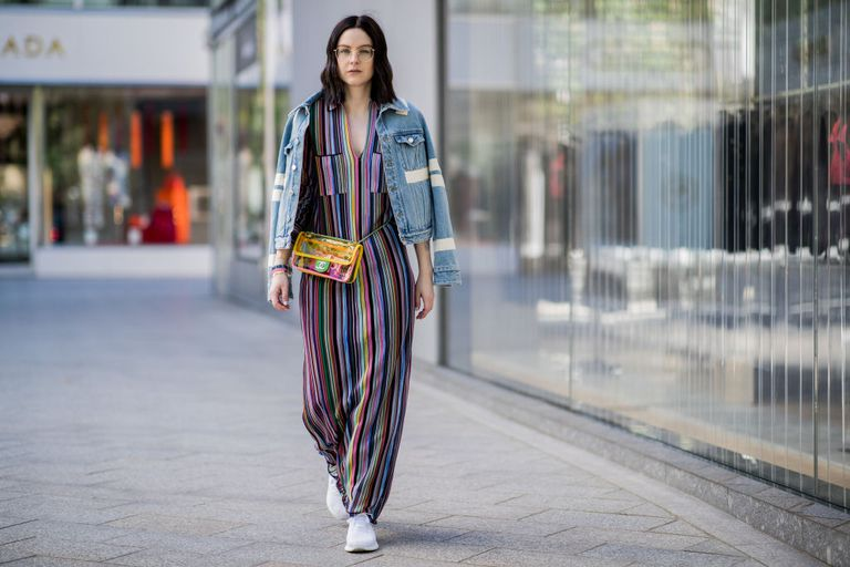 หญิง wearing a Missoni striped dress and a denim jacket
