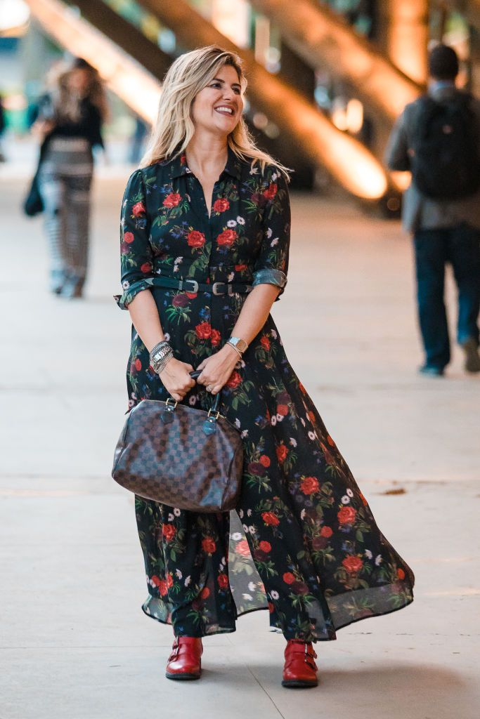หญิง wearing a black floral summer dress