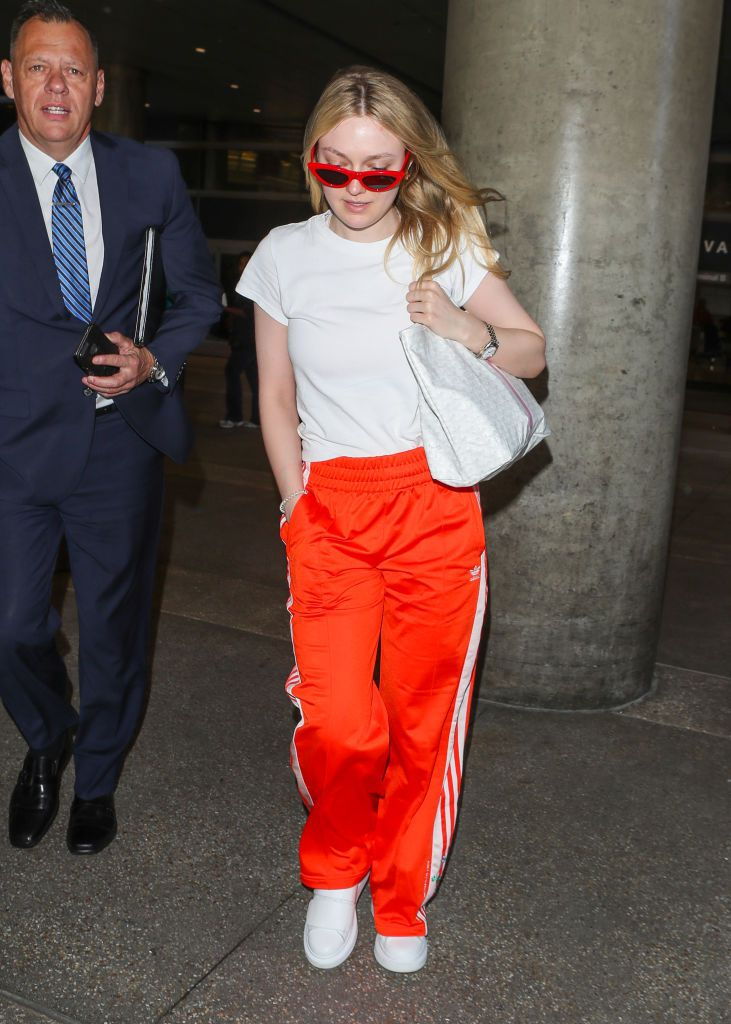 Dakota Fanning in track pants at the airport