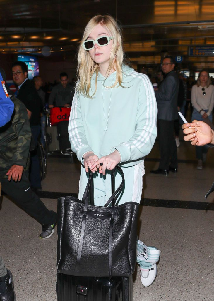 Elle Fanning at the airport