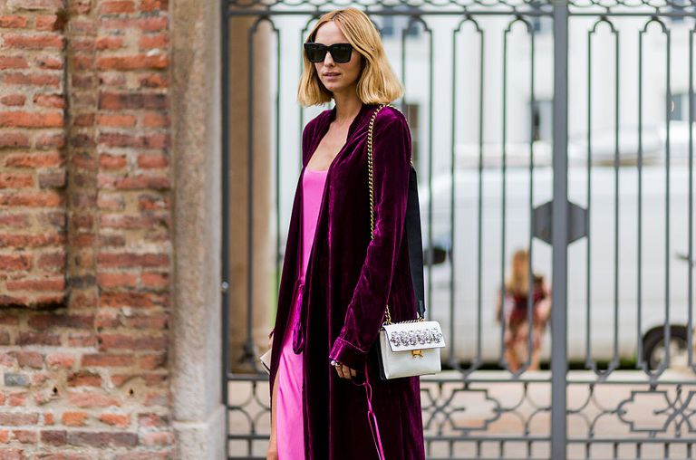 Candela Novembre wearing a pink dress and velvet is seen outside Alberta Ferretti during Milan Fashion Week Spring/Summer 2017 on September 21, 2016 in Milan, Italy.