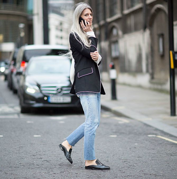 Sara Harris rocks a blazer with contrast piping over jeans