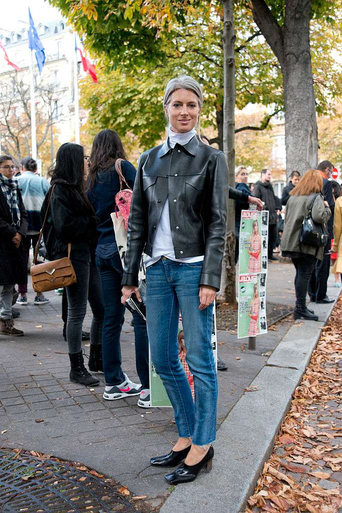 Sara Harris in biker jacket with frayed hem jeans