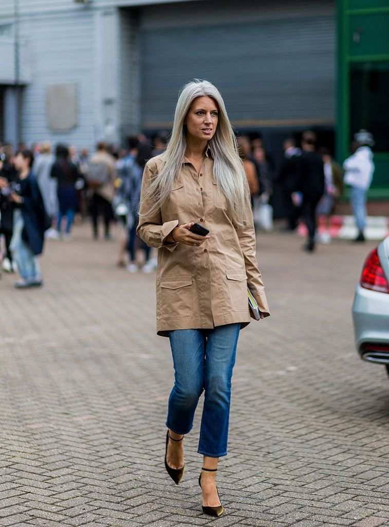 Sara Harris in jeans and trench coat